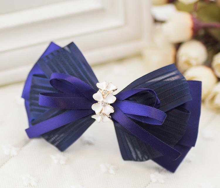 กิ๊บติดผมโบว์สีน้ำเงินแต่งดอกไม้สีขาวคริสตัล