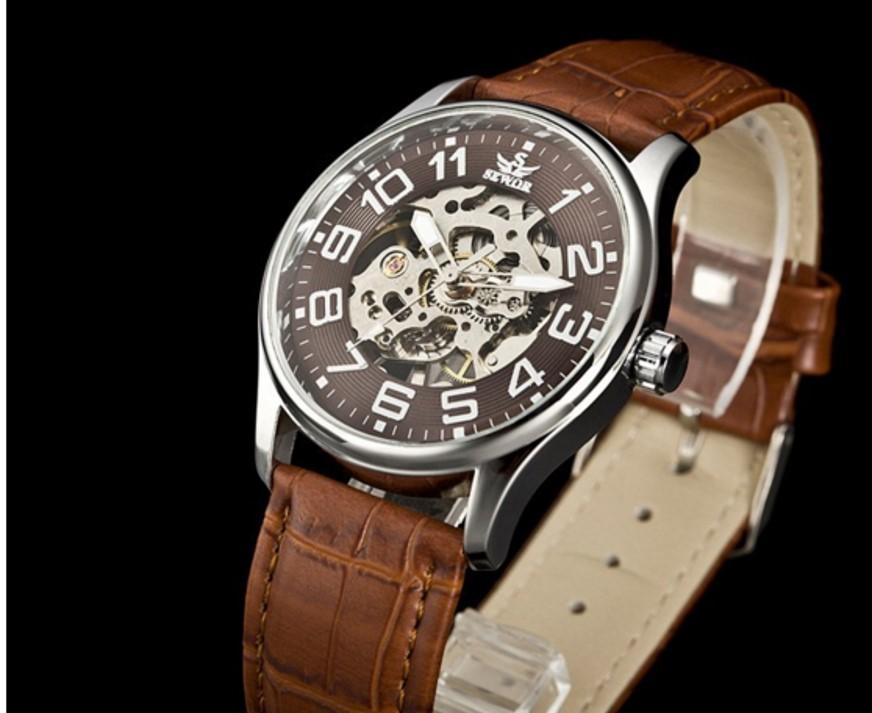 นาฬิกาข้อมือกลไกระบบไขลาน หน้าปัดดำ สายน้ำตาลโชว์เครื่องนาฬิกาด้านหลัง (พร้อมส่ง)